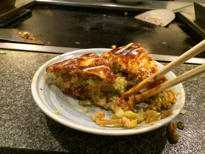 Okonomiyaki, preparing to be eaten.
