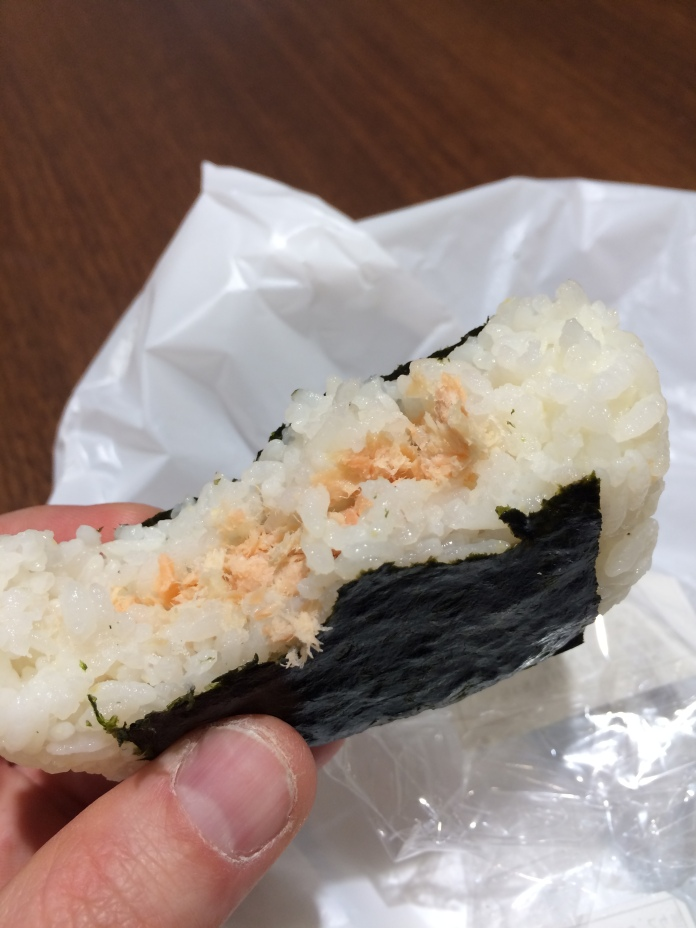 Salmon wrapped in rice, wrapped in seaweed. $1.50 Onigiri!!